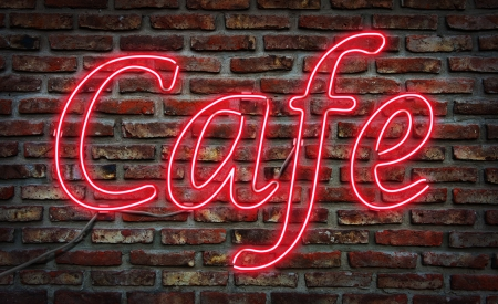 Glowing neon Cafe sing on a brick wall  photo