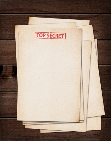 top secret files on wooden table  photo