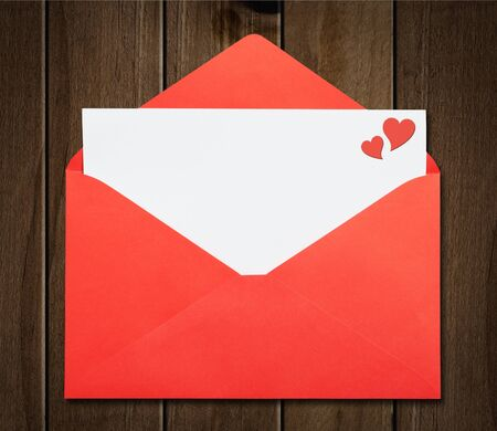 A white blank card in a opened red envelope. Valentine's day. Stock Photo - 17592472