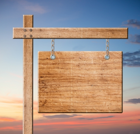 homing: Wood sign isolated on sky background with clipping path.
