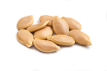 pumpkin seeds: Pumpkin seeds on white background. Stock Photo