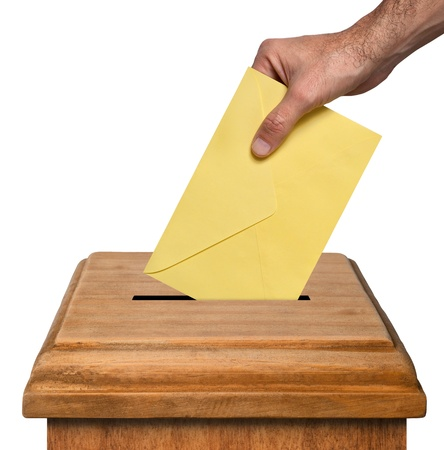 voter: Hand putting envelope into the box isolated on white background, clipping path.