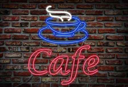 Cafe neon sign on brick background.