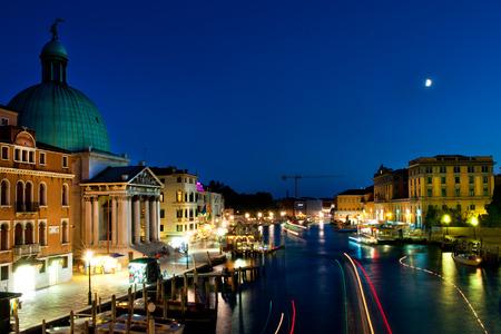 tourist attraction: Grand Canal at night, Venice. San Simeone Piccolo church with its dome. Stock Photo