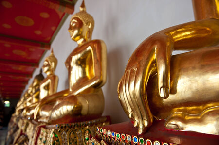 Golden Buddha statues in a Buddhist temple