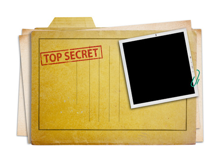secret information: top secret folder with old photograph,  isolated, clipping path. Stock Photo