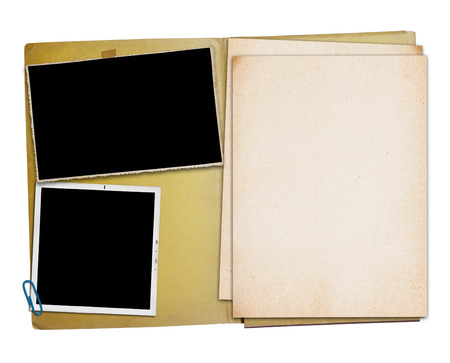 Open vintage folder with two old photographs