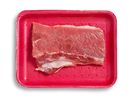 excludes: Fresh pork meat on a plastic tray. Isolated, white background, clipping path excludes the shadow.