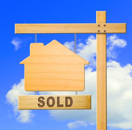 listing: Real estate sign on blue sky