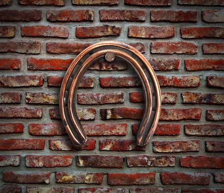 horseshoe vintage: Horseshoe hanging on brick wall.