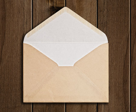 envelope: Brown Envelope  on wood background, clipping path. Stock Photo