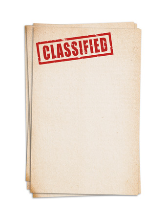 classified: Block of old papers with classified stamp. Clipping path.