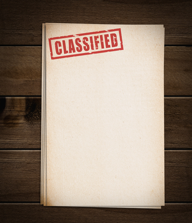 secret information: Block of old papers with classified stamp. Stock Photo