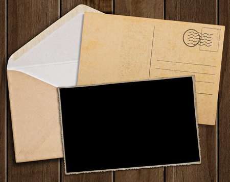 envelopes: Old postcard, photo and envelope on wooden table.