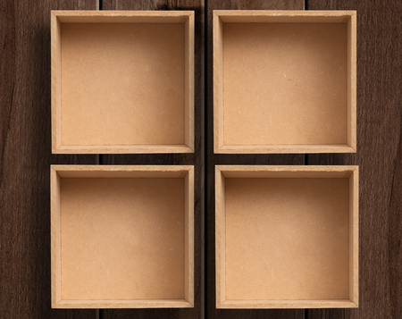 wood panel: Six empty boxes on wooden table. Stock Photo