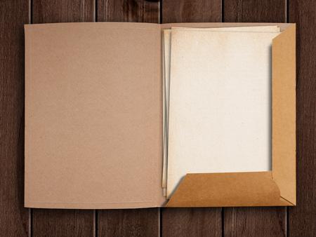 Old open folder on wooden table. Stockfoto