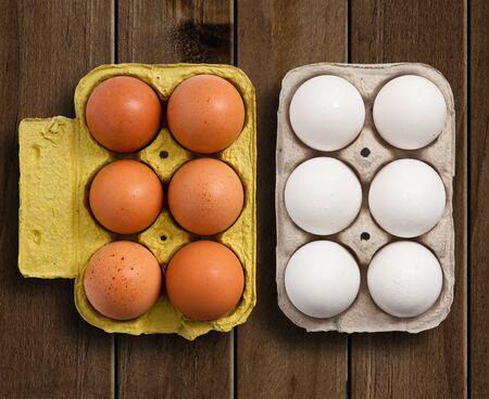 egg box: Egg box on wooden table.