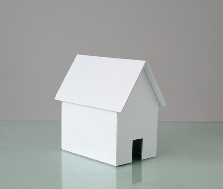 cardboard house: White cardboard house with copy space. Stock Photo