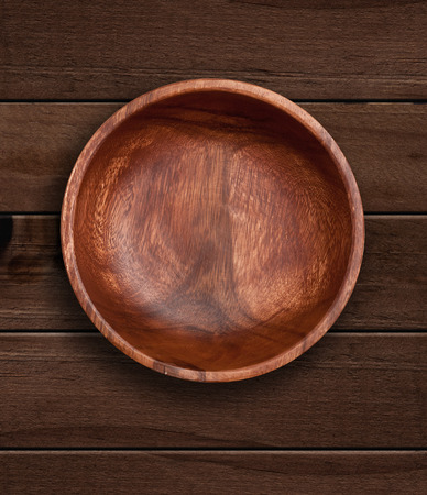 bowls: Top view of wooden bowl on  wooden background Stock Photo