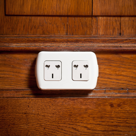 electric outlet: electric outlet in a wall in an old house interior