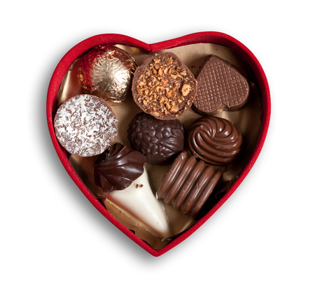 Heart shaped box  with chocolates, isolated, clipping path excludes the shadow.