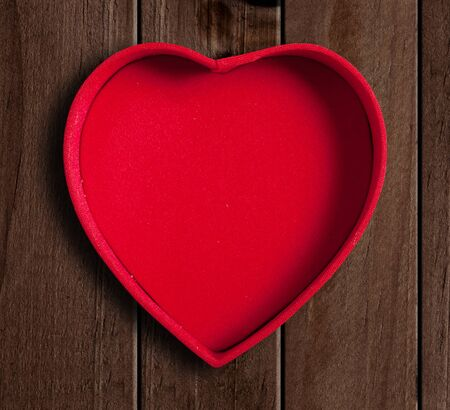 fancy sweet box: Heart shaped box on wooden background.