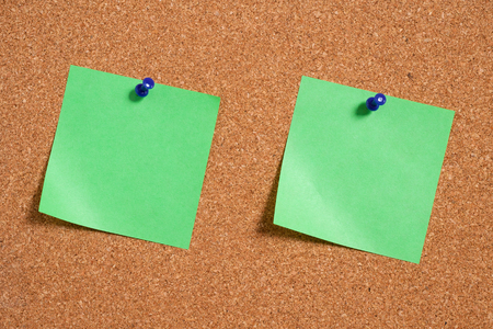 tack board: note papers on cork board