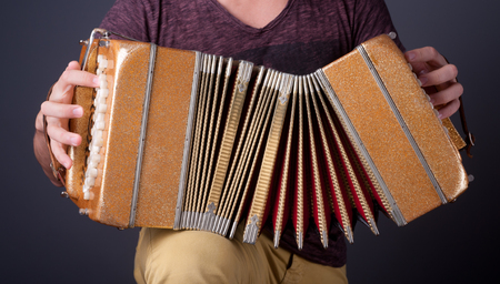 bellows: Playing the bandoneon, traditional tango instrument, Argentina. Stock Photo