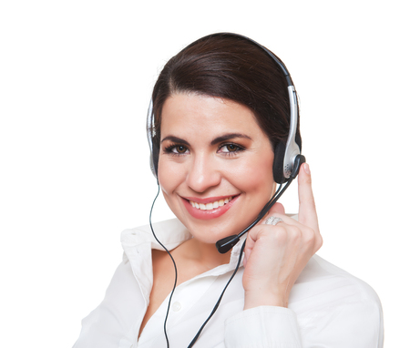 Beautiful smiling  woman using a headset, looking at camera. White background. 스톡 콘텐츠