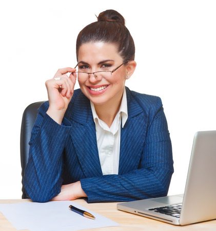 Beautiful smiling  woman using a computer and a glasses, looking at camera.