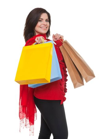 Happy woman shopping for    christmas, white background. 스톡 콘텐츠