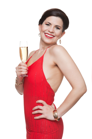 Woman in red dress with glass of sparkling wine, white background. 스톡 콘텐츠
