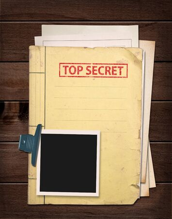top secret file on wooden table. Stockfoto