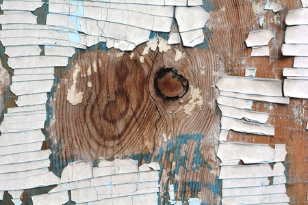 The wooden background painted surface cracked shabby