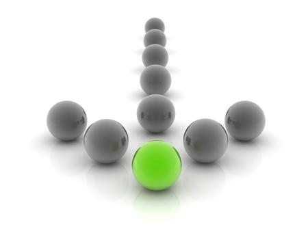een groene bol geplaatst waarneembaar in een groep grijze bollen. Stockfoto