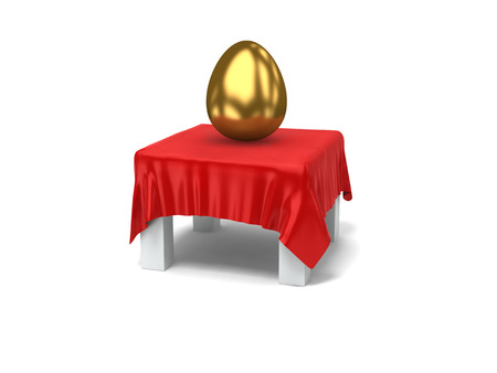 corrugation: a gold egg on a white desk covered by silk cloth.