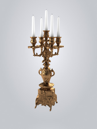 golden candlestick with white candles .
