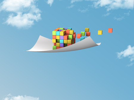 emanate: single white paper with colorful cubes flying on blue sky. Stock Photo