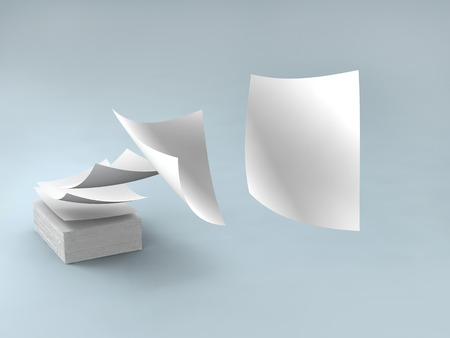 white papers falling up on gray background. Standard-Bild