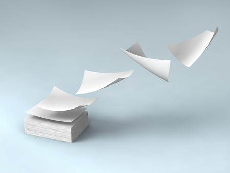office documents: white papers falling up on gray background. Stock Photo