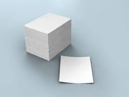 white papers piled In a heap on gray background. photo