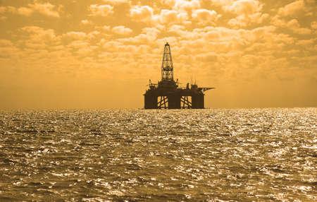 Oil rig during sunset in Baku, Azerbaijan in Caspian Sea Stock Photo