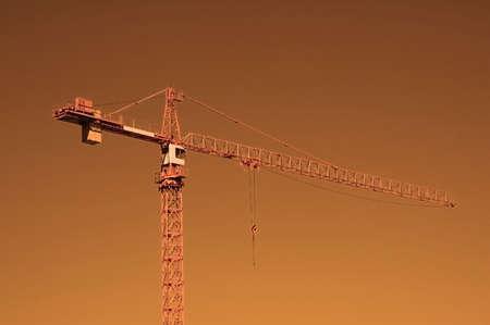Construction crane at sunset photo