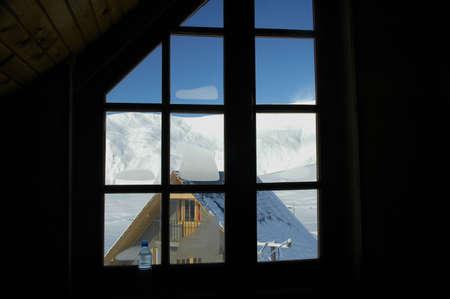 Winter mountains through the window Stock Photo - 542179
