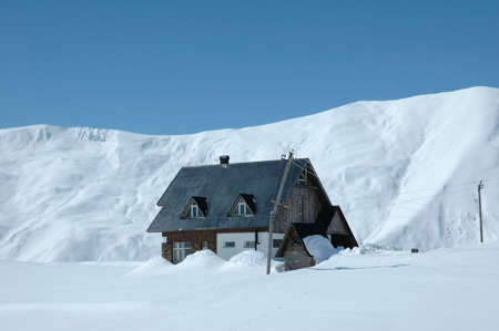 House in mountains during winter Stock Photo - 542178