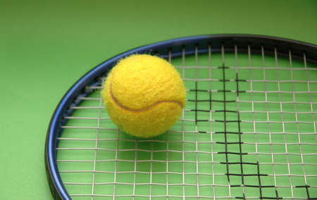 Tennis racket and ball on green background Stock Photo - 552555