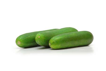 Three cucumbers isolated on white photo