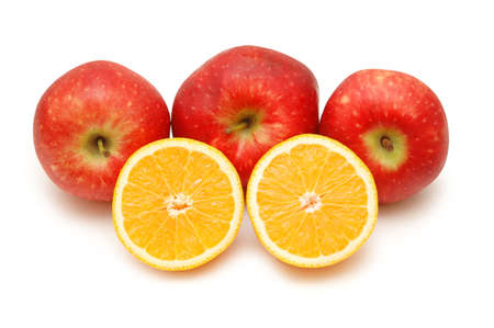 three red apples and two half-cut oranges isolated on white photo