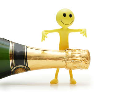 Bottle of champagne and figure of Smiley photo