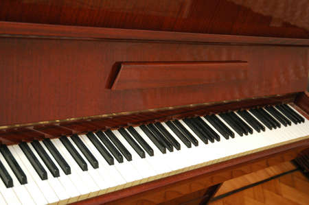 Piano with polished wooden finishing photo